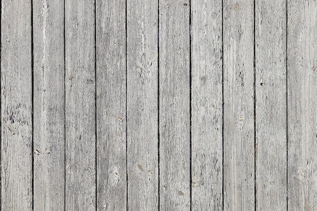 Vecchio fondo in legno di tavole con vernice grigia squallida