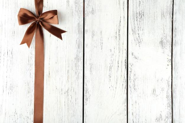 Vecchio fondo in legno con bellissimo fiocco