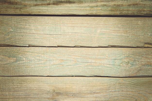 Vecchie tavole di legno tavole con rilievi incrinati e residui di vernice texture di legno vecchio.