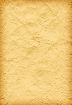 Vecchia priorità bassa gialla del grunge - carta sgualcita in bianco