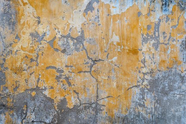 Vecchia struttura della parete dipinta giallo