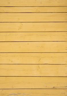 Vecchio fondo di legno strutturato giallo, superficie di vecchia struttura di legno, vista dall'alto