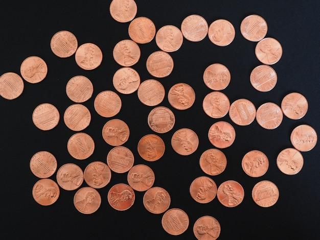 Monete da un centesimo di dollaro, stati uniti su nero