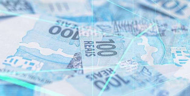 Cento banconote in reais brasiliane lanciate, cadute, concetto di crisi finanziaria brasiliana e recessione o inflazione