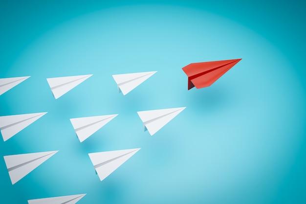 Un aeroplano di carta rossa che punta in modo diverso su sfondo blu.
