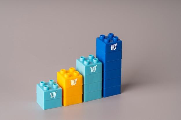 Icona dello shopping online su blocchi di plastica colorati