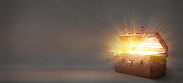 Apri un antico scrigno del tesoro che irradiava luce su un vecchio sfondo