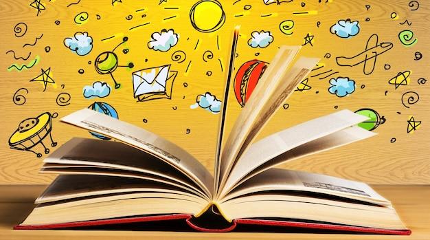 Libro aperto sul tavolo con illustrazione