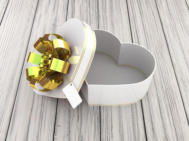 Contenitore di regalo aperto sotto forma di cuore sulla tavola di legno