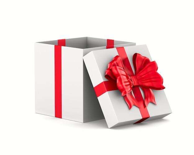Contenitore di regalo bianco aperto con fiocco rosso su uno spazio bianco