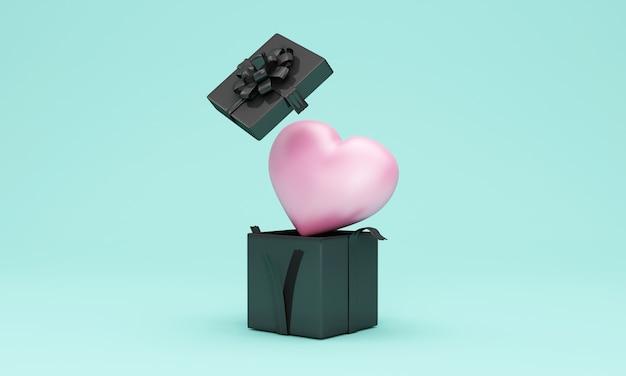 Scatola regalo nera aperta con cuore rosa all'interno su turchese
