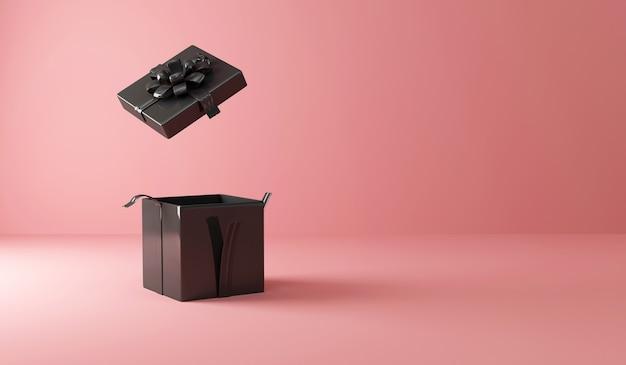 Contenitore di regalo nero vuoto aperto sul rosa con luce