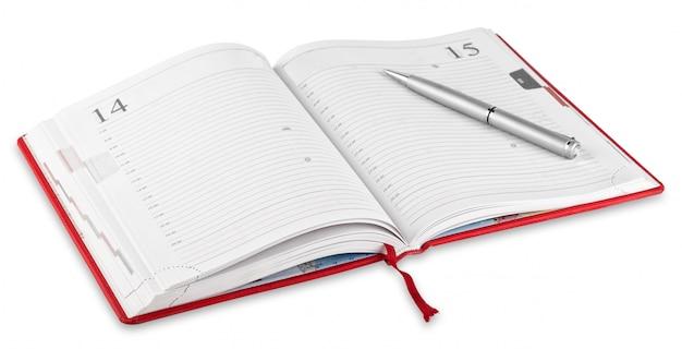 Diario e penna rossi aperti
