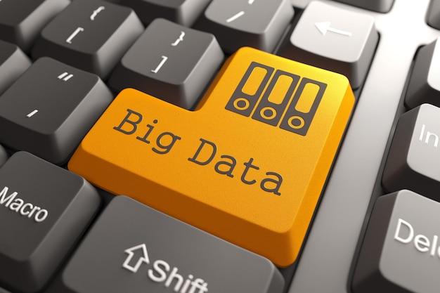 Pulsante arancione big data sulla tastiera del computer. concetto di informazioni.