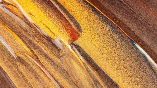 Sfondo marrone arancione con macchie scintillanti. concetto di trucco. sfondo festivo