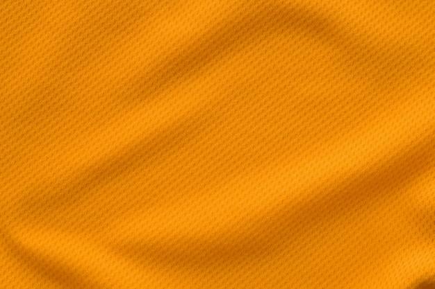 Colore arancione abbigliamento sportivo tessuto jersey maglia da calcio texture vista dall'alto