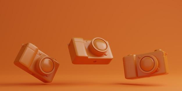 Fotocamera digitale arancione su sfondo arancione, concetto di tecnologia. rendering 3d