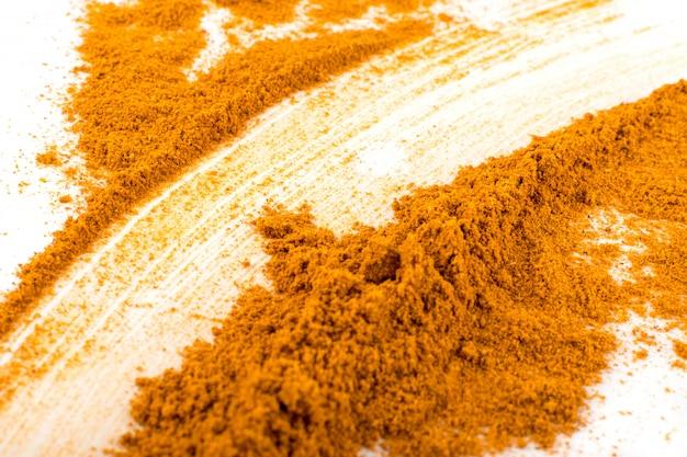 Vista dall'alto di sfondo arancione condimento in polvere