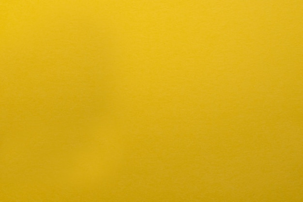 Sfondo giallo arancio con sfondo a trama scura