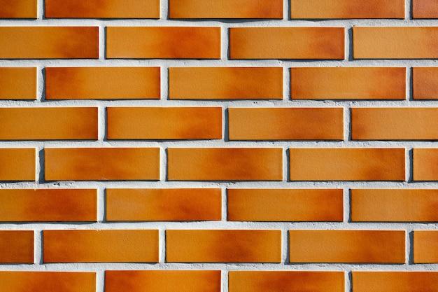 Il nuovo muro di mattoni marrone arancio texture sfondo moderno muro di mattoni texture un muro fotografato su un...
