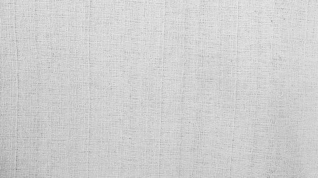 Sfondo di cotone tessuto organico tela di lino bianca tessuto di cotone naturale stropicciato tessuto di lino naturale fatto a mano vista dall'alto sfondo tessuti organici eco tessuto bianco trama di cotone di lino