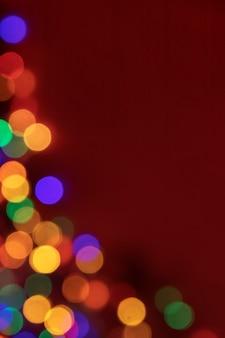 Fuori fuoco punti colorati di luci per lo sfondo di natale di capodanno
