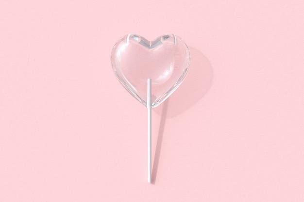 Lecca-lecca di caramella di vetro a forma di cuore eccezionale su sfondo di colore rosa. rendering 3d. idea minima del concetto di san valentino.