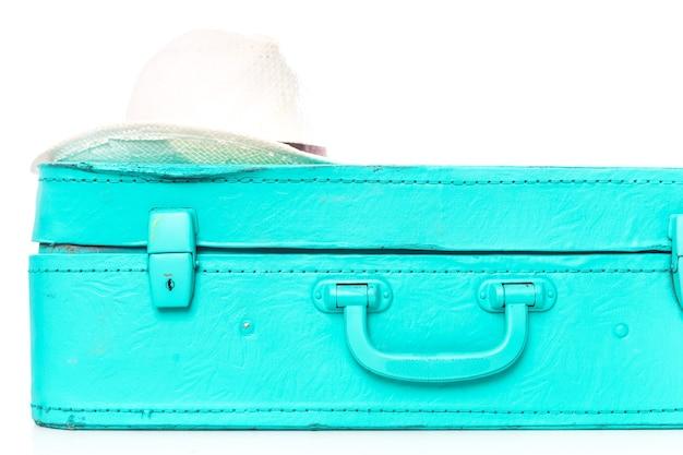 Valigia di imballaggio per il viaggio isolato su bianco