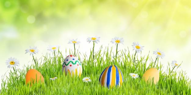 Uova dipinte e fiori in erba verde, priorità bassa di festa di pasqua