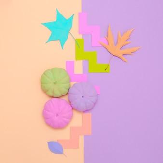 Zucche dipinte autunno composizione creativa. design minimale delle stagioni autunnali piatto alla vaniglia