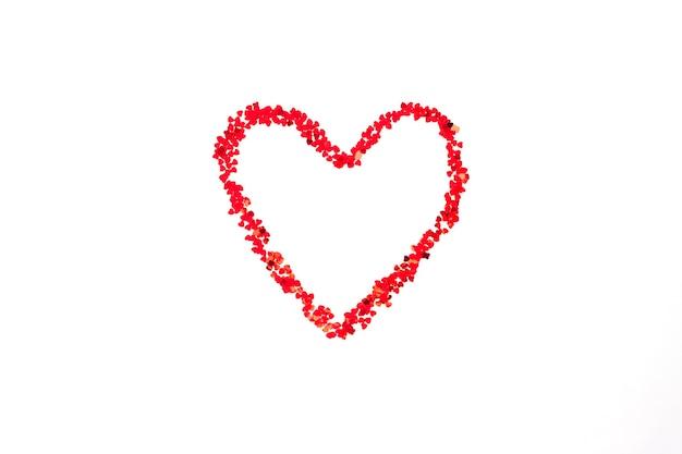 Cuore rosso dipinto fatto di tanti piccoli cuori.