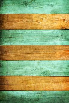 Fondo strutturato delle plance di legno dipinto con vignettatura delicata