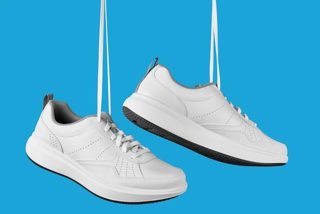 Un paio di scarpe da ginnastica maschili bianche Foto Premium