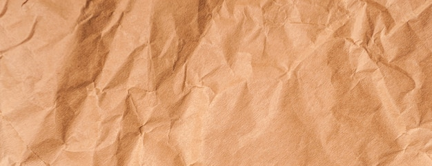 Trama panoramica della vecchia carta stropicciata gialla