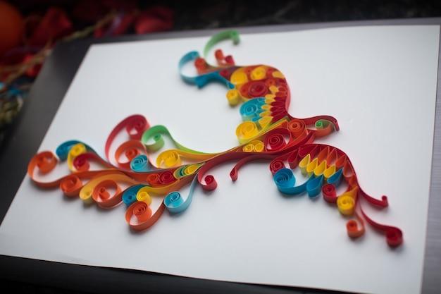 Paper firebird realizzato con tecnica artigianale quilling