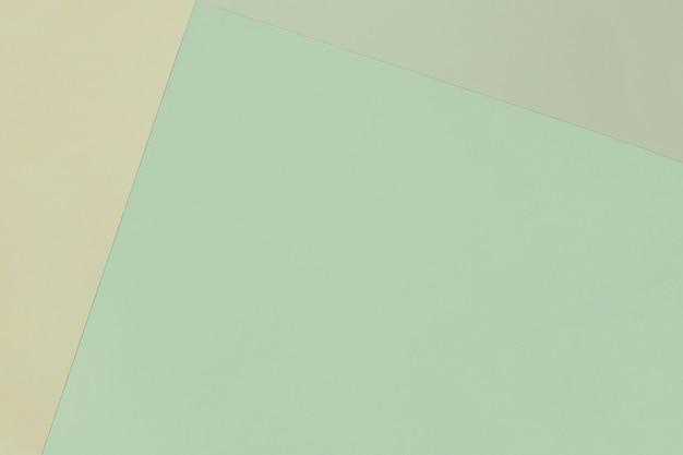 Fondo pastello geometrico di carta nei colori verdi con lo spazio della copia.