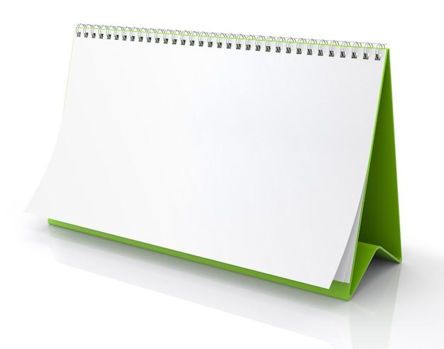 Sul tavolo c'è un calendario di carta bianca. isolato su sfondo bianco - 3d illustration