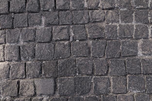 Struttura della pavimentazione. vecchia pavimentazione in mosaico di pietra modello.