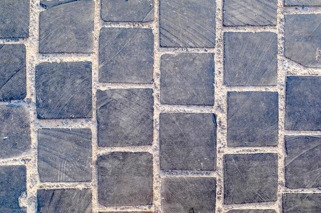 Pietra per lastricati, pietre quadrate di granito, trama di sfondo. foto di alta qualità