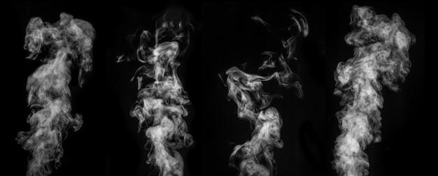 Un set perfetto di quattro diversi vapori bianchi ricci mistici o fumo su sfondo nero. nebbia o smog di sfondo astratto, elemento di design per halloween, layout per collage.
