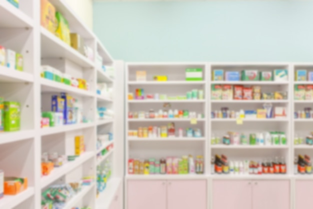 La farmacia della farmacia sfoca il backbround astratto con la medicina e il prodotto sanitario sugli scaffali