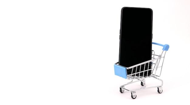 Telefono e carrello della spesa