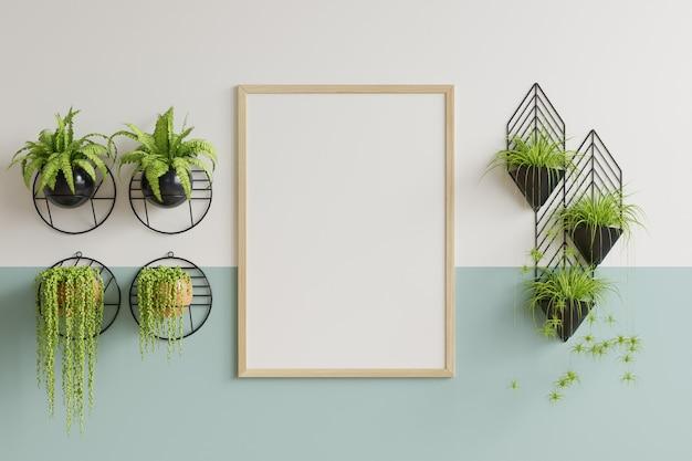 Cornice per foto su una parete verde e bianca nel soggiorno con vasi decorativi per piante