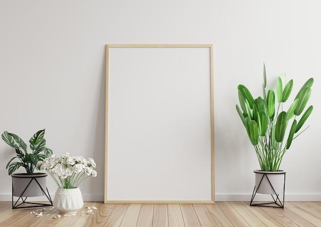 Portafoto in camera sul muro bianco sul pavimento in legno, decorato con piante