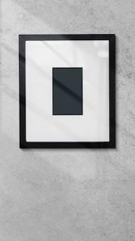 Cornice per foto su uno sfondo del telefono cellulare a parete