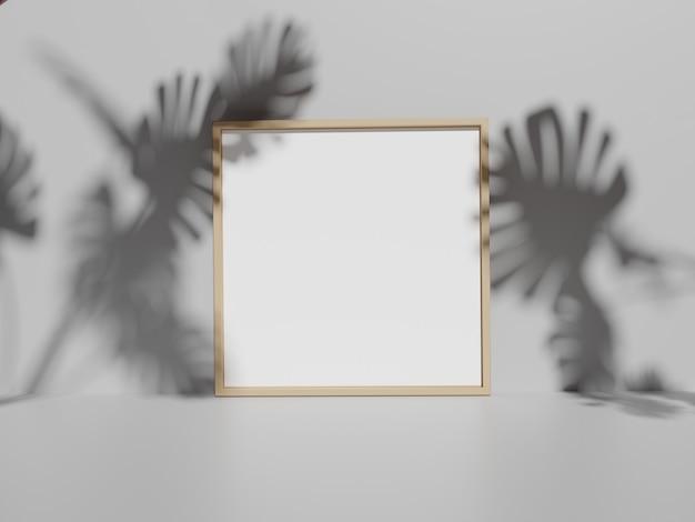 Cornice per foto sul muro bianco con monstera lascia ombre
