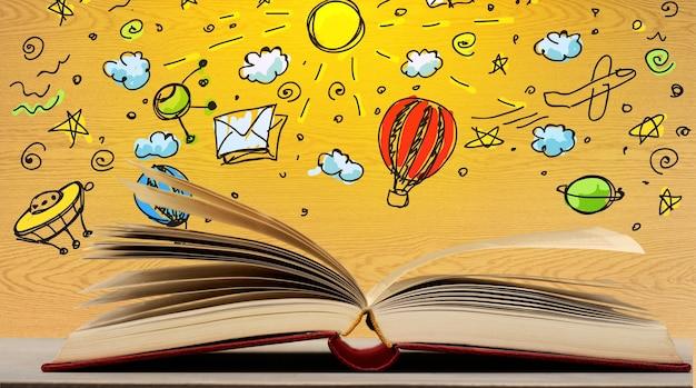 Foto di una pila di libri antichi. il libro in alto è aperto con una serie di infografiche.