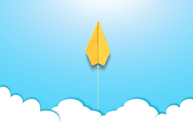La fotografia dell'aereo di carta giallo origami sta volando sopra il cielo su sfondo blu con illustrat