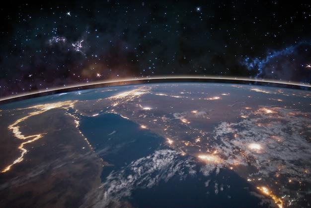 Immagine della terra nello spazio, stelle tutt'intorno, cielo notturno. elementi di questa immagine forniti