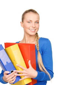 Foto di una giovane donna d'affari attraente con cartelle